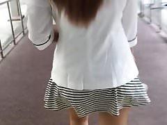 Slut in stripe dress back view