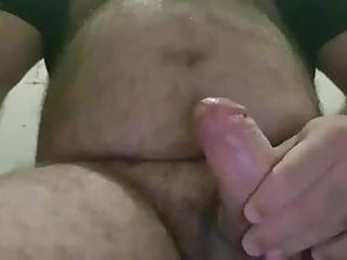 My bear sub jerking off for me and he cums a lot!
