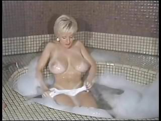 At home taking a bubble bath...