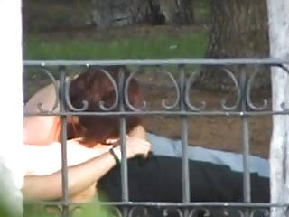 BEHIND THE FENCE HANDJOB!!!!