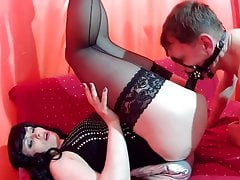 Slave guy fucks Mistress's pussy with a dildo in his mouth. 3