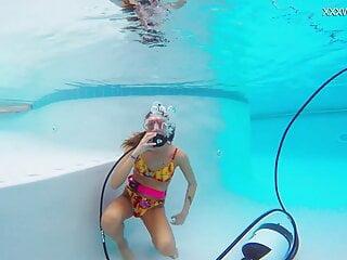 Katya Nakolkina with another girl in the pool