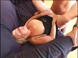Short-haired GILF satisfying an younger guy