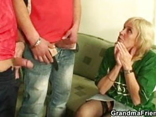 Blonde granny takes two stiff rods at once...