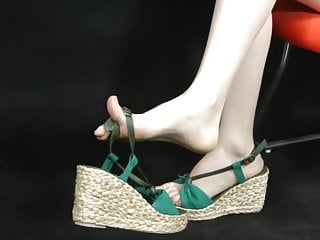 Showing in wedge espadrille style sandals zoom...