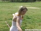 Innocent teen Kitty flying her kite
