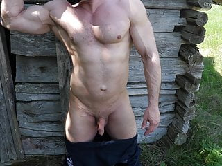 Muscle construction worker shows his big dick behind the bar