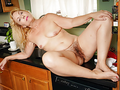 american gilf justine lowers her panties in the kitchenfree full porn