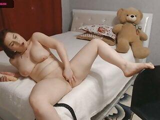 Big ass Russian milf caresses her pussy
