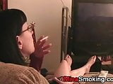 Girlfriend gaming and  smoking a cigarette