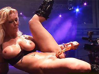 busty german milf toying on public stagePorn Videos