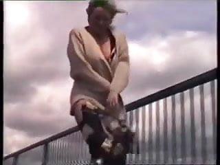 Naked under coat walking on overbridge...
