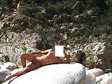 Naked boy on the beach, cute naturist,