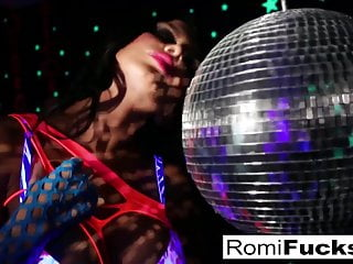 Romi plays with a disco ball before stuffing toying her