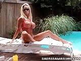 Busty blonde in micro bikini. Huge fake boobs