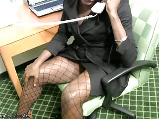 Secretary strips off while having a phone sex...