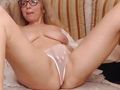 Mature Ukrainian woman in lingerie caresses her body and pussy