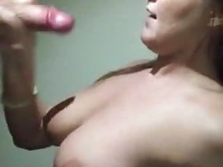 She gives him a blowjob and he cums on her face and boobs