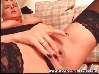 Pierced nipples MILF in black stockings rubbing shaved pussy