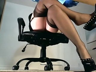 Underdesk tease showing stockings over nylons