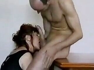 they both suck his huge white cock at the same time