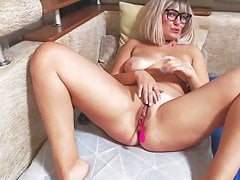 Russian blonde in glasses affectionately caresses her pussy