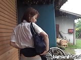 Japanese schoolgirl soaks her panties up at a rainy day