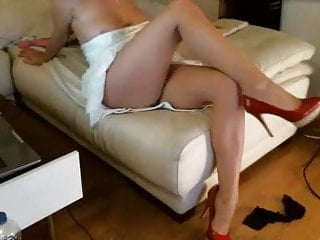 Blonde Milf in heels teases pussy with dildo