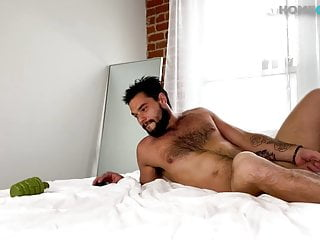 Muscle cub fingering his ass in a solo action