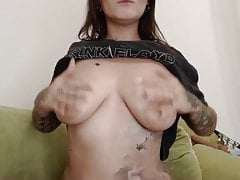 Punk girl rubs pussy, sings, and reveals big boobs