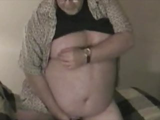 Older chubby guy pulling his meat.
