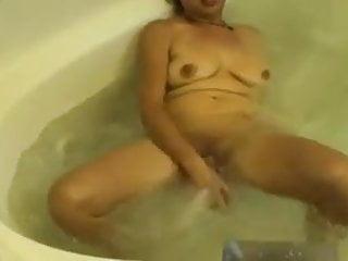 Granny fucks her cunt hot tub...