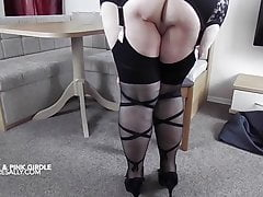 Busty mature in corset and stockings