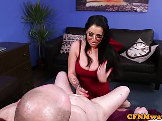 Bigtitted british babe jerking her subs cock
